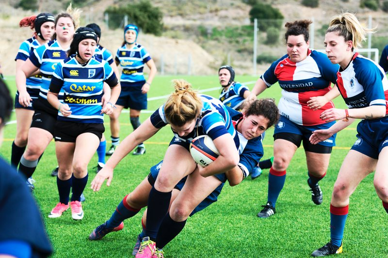 woman rugby players wearing mouthguards